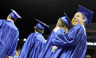 Jeff Krage – For the Northwest Herald Dundee-Crown graduate reacts to a member of the audience during the processional of Saturday's graduation at the Sears Centre. Hoffman Estates 5/19/12