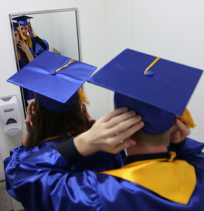 Jeff Krage – For the Northwest Herald Dundee-Crown graduate's Andrew Kryca and Emma Gentile check themselves in a mirror before the start of Saturday's graduation ceremonies at the Sears Centre. Hoffman Estates 5/19/12