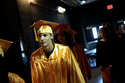 Daniel J. Murphy - dmurphy@shawmedia.com  Nicholas Lavalle walks to his seat during the Jacobs High School commencement Saturday May 19, 2012 at the Sears Centre Arena in Hoffman Estates.