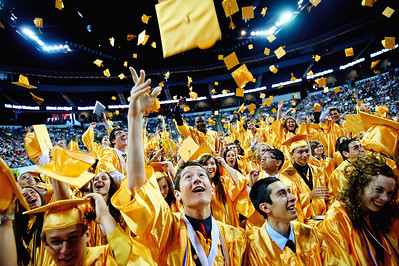 Daniel J. Murphy - dmurphy@shawmedia.com  James Fletcher (center) and fellow graduates throw their caps after the Jacobs High School commencement ceremony Saturday May 19, 2012 at the Sears Centre Arena in Hoffman Estates.