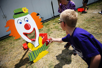 "Daniel J. Murphy - dmurphy@shawmedia.com  William Niese, 7, of McHenry throws a bean bag in the ""clown toss"" event during the Spring into Health Kids Fair Saturday May 19, 2012 at Advocate Good Shepherd Hospital in Barrington. The first 500 children registered will received a free bike helmet with proper fittings provided by Good Shepherd Hospital's emergency room staff."