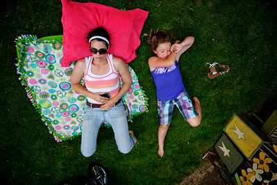 "Daniel J. Murphy - dmurphy@shawmedia.com  Kelly VanDerWeele from Argos, IN lays on the grass with her daughter Emma Swathwood, 8, Sunday May 20, 2012 in Woodstock. Vendors lined the Woodstock square Sunday for the 44th annual ""Fair Diddley"" craft show which benefits mental health related agencies in McHenry County."