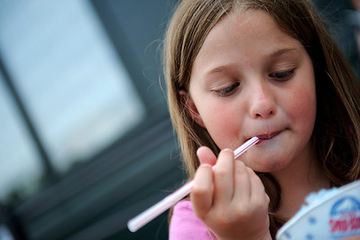 "Daniel J. Murphy - dmurphy@shawmedia.com  Tegan Mears, 8, of Woodstock devours a snow-cone Sunday May 20, 2012 in Woodstock. Vendors lined the Woodstock square Sunday for the 44th annual ""Fair Diddley"" craft show which benefits mental health related agencies in McHenry County."