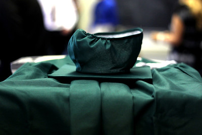 Sarah Nader - snader@shawmedia.com A cap an grown is placed on a table before the 2012 Alden-Hebron Commencement in Hebron on Sunday, May 20, 2012.