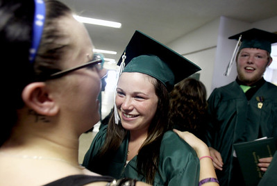 Sarah Nader - snader@shawmedia.com Alexia Wanderer (right) 18, of Hebron hugs her best friend, Melanie Winter, 19, of Woodstock after the 2012 Alden-Hebron Commencement in Hebron on Sunday, May 20, 2012.