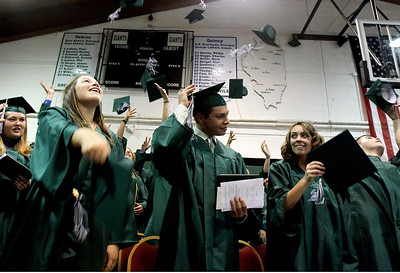 Sarah Nader - snader@shawmedia.com Hebron graduates throw up their caps during the 2012 Alden-Hebron Commencement in Hebron on Sunday, May 20, 2012.