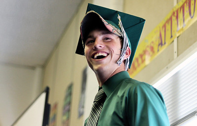 Sarah Nader - snader@shawmedia.com Nicholas Nelson, 18, of Hebron wears a hat under his graduation cap before the 2012 Alden-Hebron Commencement in Hebron on Sunday, May 20, 2012.
