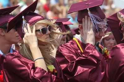 Mike Greene - mgreene@shawmedia.com Richmond-Burton students brace their caps from high winds during graduation ceremonies for Richmond-Burton High School Sunday, May 20, 2012 in Richmond.