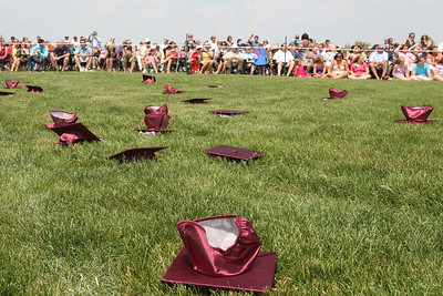 Mike Greene - mgreene@shawmedia.com Caps are scattered on the ground after being tossed by students during graduation ceremonies for Richmond-Burton High School Sunday, May 20, 2012 in Richmond.