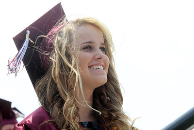 Mike Greene - mgreene@shawmedia.com Richmond-Burton student Tiffany Springsteen smiles while waiting to receive her diploma during graduation ceremonies for Richmond-Burton High School Sunday, May 20, 2012 in Richmond.