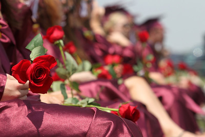 Mike Greene - mgreene@shawmedia.com Richmond-Burton students hold roses for giving to their parents during graduation ceremonies for Richmond-Burton High School Sunday, May 20, 2012 in Richmond.