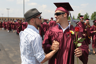Mike Greene - mgreene@shawmedia.com Jeff Kukkla (left) greets Richmond-Burton student Alex Barth prior to the start of graduation ceremonies for Richmond-Burton High School Sunday, May 20, 2012 in Richmond.