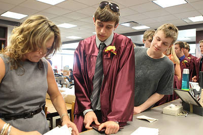 Mike Greene - mgreene@shawmedia.com Richmond-Burton student Brandon Puleo waits to receive his diploma after graduation ceremonies for Richmond-Burton High School Sunday, May 20, 2012 in Richmond.