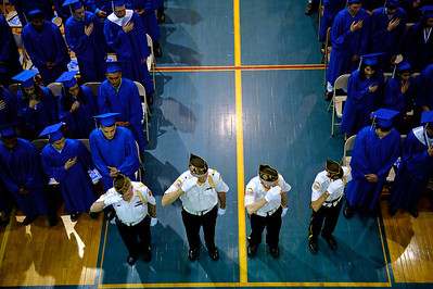 Daniel J. Murphy - dmurphy@shawmedia.com  The color guard salutes the American Flag during the National Anthem during the 135th Commencement Ceremony Sunday May 20, 2012 at Woodstock High School.