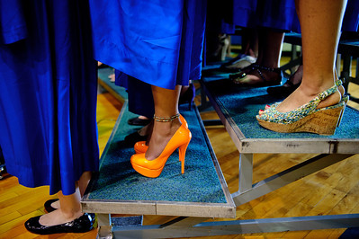 Daniel J. Murphy - dmurphy@shawmedia.com  Choir singer Krystal Sanke (center) sports bright orange shoes while singing the school song during the 135th Commencement Ceremony Sunday May 20, 2012 at Woodstock High School.