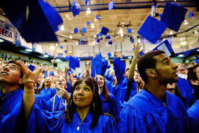 Daniel J. Murphy - dmurphy@shawmedia.com  Justine Aparri, 17, (center) tosses her cap following the 135th Commencement Ceremony Sunday May 20, 2012 at Woodstock High School.