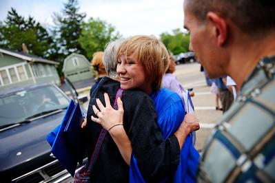 Daniel J. Murphy - dmurphy@shawmedia.com  Adi Hicks, 17, (right) hugs her grandmother Susan Tauck following the 135th Commencement Ceremony Sunday May 20, 2012 at Woodstock High School.