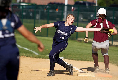 Sarah Nader - snader@shawmedia.com Marengo's Reed Kartsen (right) is safe at first after Cary-Grove's Sarah Kendeigh barely misses the ball during the sixth inning of Monday's  game in Marengo on May, 21, 2012. Marengo won, 1-0.