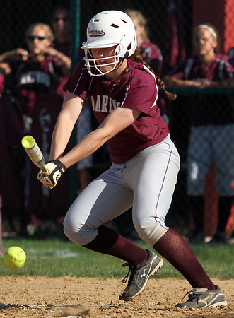 Sarah Nader - snader@shawmedia.com Marengo's Larissa Pfeiffer makes contact with the ball during the third inning of Monday's home game against Cary-Grove on May, 21, 2012. Marengo won, 1-0.