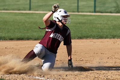 Sarah Nader - snader@shawmedia.com Marengo's Reed Kartsen slides safely into third base during the sixth inning of Monday's home game against Cary-Grove on May, 21, 2012. Marengo won, 1-0.