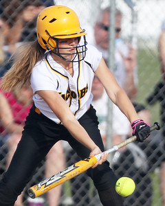 Mike Greene - mgreene@shawmedia.com Jacobs' Katie Kirker bunts against Crystal Lake South during the Class 4A Regional Semifinals Wednesday, May 23, 2012 in Huntley. Jacobs won the game 4-0 to advance to the regional finals Saturday.