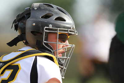 Mike Greene - mgreene@shawmedia.com Jacobs' Kelsey Cummings looks to the dugout for a sign while catching against Crystal Lake South during the Class 4A Regional Semifinals Wednesday, May 23, 2012 in Huntley. Jacobs won the game 4-0 to advance to the regional finals Saturday.