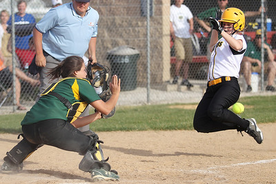 Mike Greene - mgreene@shawmedia.com Crystal Lake South's Liz Adams blocks the plate waiting for the ball as Jacobs' Kaitlynn Woloszyk slides into home during the Class 4A Regional Semifinals Wednesday, May 23, 2012 in Huntley. Wolosyzk was out at the plate, but Jacobs won the game 4-0 advancing to the finals Saturday.