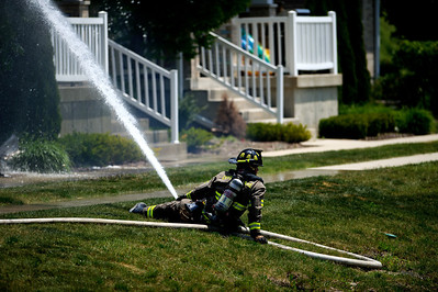 Daniel J. Murphy - dmurphy@shawmedia.com  A firefighter battles a fire at a condominium at 1216 Walnut Glen Drive in Crystal Lake Thursday May 24, 2012