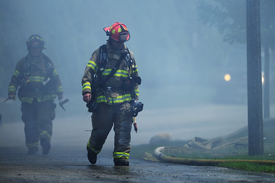Daniel J. Murphy - dmurphy@shawmedia.com  Firefighters at the scene of a condominium fire at 1216 Walnut Glen Drive in Crystal Lake Thursday May 24, 2012