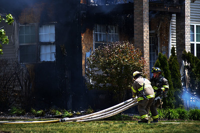 Daniel J. Murphy - dmurphy@shawmedia.com  Firefighters battle a fire at a condominium at 1216 Walnut Glen Drive in Crystal Lake Thursday May 24, 2012