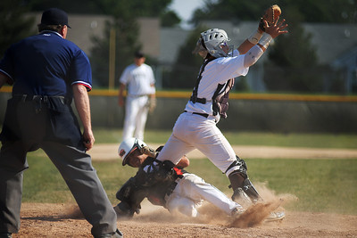 Daniel J. Murphy - dmurphy@shawmedia.com  Huntley's Nick Corpolongo slides into home plate in the first inning for a score Thursday May 24, 2012 at Huntley High School. Jacobs defeated Huntley 8-4 in the Class 4A Huntley Regional semifinal.