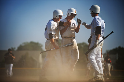 Daniel J. Murphy - dmurphy@shawmedia.com  Jacobs' Jon Berndt (left) and Mat Hickey (center) celebrate consecutive runs in the third inning with teammate Ryan Ulmer (right) Thursday May 24, 2012 at Huntley High School. Jacobs defeated Huntley 8-4 in the Class 4A Huntley Regional semifinal.