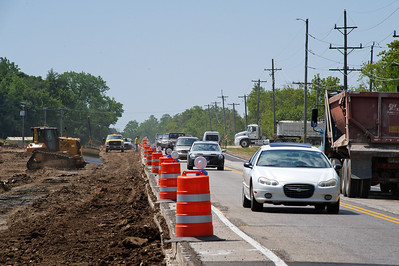 Daniel J. Murphy - dmurphy@shawmedia.com  Construction crews work to widen Highway 31 between Crystal Lake and Algonquin on Thursday May 24, 2012.