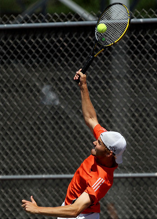 Sarah Nader - snader@shawmedia.com McHenry's Jake Romme returns a serve from a New Trier player  during a first round doubles game at the IHSA State Tennis Tournament in Elk Grove Village on Thursday, May 24, 2012.