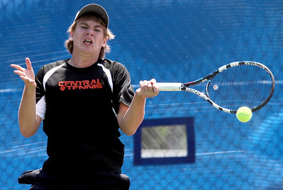 Sarah Nader - snader@shawmedia.com Crystal Lake Central's Josh Pudlo returns a serve during a second round singles game at the IHSA State Tennis Tournament in Hoffman Estates on  Thursday, May 24, 2012.