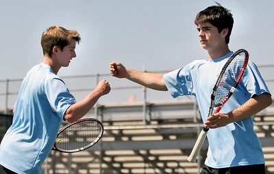 Sarah Nader - snader@shawmedia.com Marian Central's Aaron Waters (left) and his teammate, Riley Waters celebrate a point during a first round doubles game at the IHSA State Tennis Tournament in Elk Grove Village on Thursday, May 24, 2012.