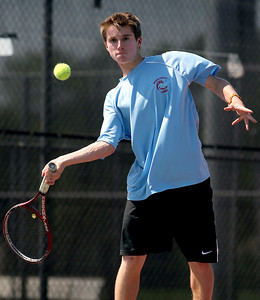 Sarah Nader - snader@shawmedia.com Marian Central's Aaron Waters returns a serve to a Marion player during a first round doubles game at the IHSA State Tennis Tournament in Elk Grove Village on Thursday, May 24, 2012.