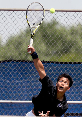 Sarah Nader - snader@shawmedia.com Hampshire's Christian Dela Cruz serves to Metamora's Mitchell Nguyen during a first round singles game at the IHSA State Tennis Tournament in Hoffman Estates on  Thursday, May 24, 2012.