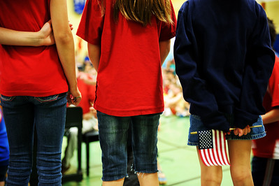 Daniel J. Murphy - dmurphy@shawmedia.com  From left: Leoni Wachner, 9, Kasia Krol, 9, and Abigaim Shew, 9, sing in a Memorial Day ceremony honoring veterans Friday May 25, 2012 at South Elementary School in Crystal Lake.