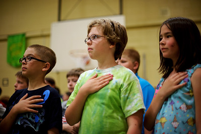 Daniel J. Murphy - dmurphy@shawmedia.com  From left: Aidan Kovacs, 9, Miranda Allen, 10, and Samantha Roewer, 9, hold their hand over their heart in respect of the color guard attending to the flag Friday May 25, 2012 at South Elementary School in Crystal Lake. Students held a Memorial Day ceremony honoring veterans.