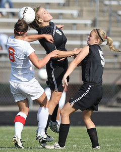Mike Greene - mgreene@shawmedia.com Prairie Ridge's Jordan Reitz (center) headers the ball while surrounded by teammate Cassie Warton and Freeport's Megan Schierer during the Class 2A Sectional Championship Friday, May 25, 2012 in Belvidere. Freeport won the game 2-1.