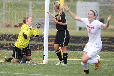 Mike Greene - mgreene@shawmedia.com Prairie Ridge's Brooke Laibly holds onto the net while teammate Ali Fanning looks on after Freeport scored to take the lead late in the second half during the Class 2A Sectional Championship Friday, May 25, 2012 in Belvidere. Freeport won the game 2-1.
