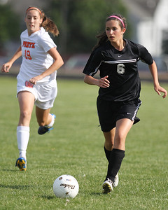 Mike Greene - mgreene@shawmedia.com Prairie Ridge's Allyson Walsh dribbles the ball down field as Freeport's Mariah Katzenberger pursues during the Class 2A Sectional Championship Friday, May 25, 2012 in Belvidere. Freeport won the game 2-1.