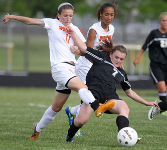 Mike Greene - mgreene@shawmedia.com Freeport's Julia Luecke and Prairie Ridge's Bri Fenton fight for posession during the Class 2A Sectional Championship Friday, May 25, 2012 in Belvidere. Fenton scored Prairie Ridge's only goal. Freeport won the game 2-1.