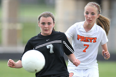 Mike Greene - mgreene@shawmedia.com Prairie Ridge's Bri Fenton and Freeport's Allyson Hayner vie for a bouncing ball during the Class 2A Sectional Championship Friday, May 25, 2012 in Belvidere. Fenton scored Prairie Ridge's only goal. Freeport won the game 2-1.