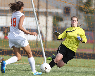 Mike Greene - mgreene@shawmedia.com Freeport's Darice Brooks takes a shot on goal against Prairie Ridge's Brooke Laibly during the Class 2A Sectional Championship Friday, May 25, 2012 in Belvidere. Laibly blocked the shot, but Freeport would go on to win the game 2-1.