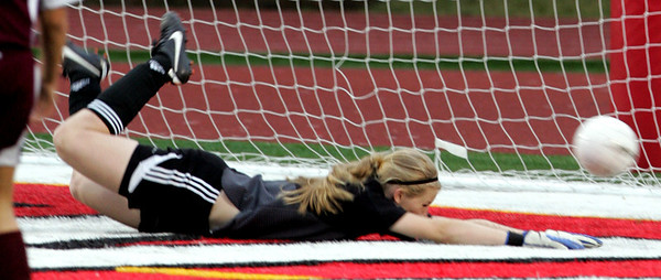 iRichmond-Burton's keeper Hannah Koenig can not block the rebound as Quincy Noter Dame scores in the first half n the IHSA Class 1A State Final Friday May 25, 2012 at North Central College Benedetti-Wehrli Stadium in Naperville.
