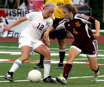 iRichmond-Burton's Miki Winkler (right) battles Quincy Notre Dame's Shannon Foley for control in the first half.