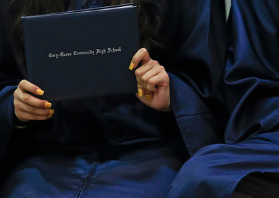 Brett Moist for the Northwest Herald Cary Grove High School Graduate recieved diploma jackets to display their diplomas during the Senior Graduation Ceremony at Cary Grove High School on Saturday.