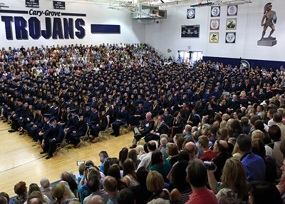 Brett Moist for the Northwest Herald Cary Grove graduates sit and listen to speakers during the Senior Graduation Ceremony at Cary Grove High School on Saturday.